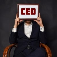 Man with CEO sign